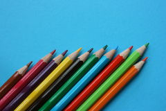 Colourful alignment pointing upwards. Color pencils of different colors, pointing up Royalty Free Stock Image