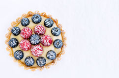 Colourful appetising tart. Top down perspective of a brightly coloured mix berry dessert royalty free stock photos