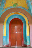 Colourful arched spanish door Stock Image