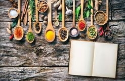 Various herbs and spices for cooking on old wooden board royalty free stock photo