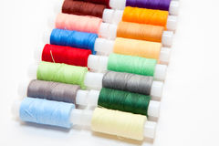 Colourful arranged reel of thread Royalty Free Stock Images