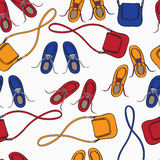 Colourful array of shoes and handbags Stock Images