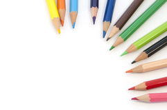 Colourful art pencils on white blank Royalty Free Stock Photo