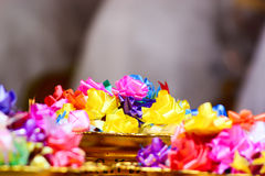 Colourful artificial flower on gold tray. Artificial flower made from ribbons by handcraft in Thailand Stock Image
