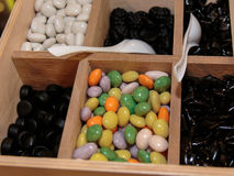 Colourful Assorted Sugared Almonds in Wooden Box stock photography