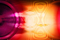 Colourful audio speaker with soundwaves. Red and yellow audio speaker and soundwaves background Stock Photo