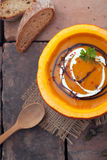 Colourful autumn pumpkin soup in the gourd Stock Images