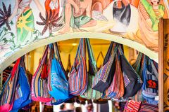 Colourful bags and colourful facade stock images
