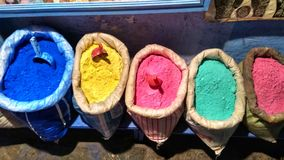 Colourful bags of pigments stock image