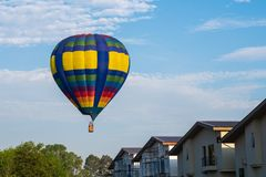 Colourful of balloon on blue sky with home village. And trees stock photography