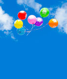 Colourful balloons in blue sky Stock Photo