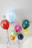 Colourful balloons on ceiling Royalty Free Stock Images