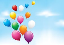 Colourful balloons in a cloudy sky Royalty Free Stock Photos