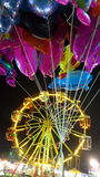 Colourful balloons  and ferris wheel in temple fair Royalty Free Stock Photo