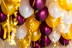 Colourful balloons, golden, white, red, streamers  Royalty Free Stock Image