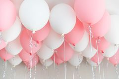 Colourful balloons, pink, white, streamers. Helium Ballon floating in birthday party. Concept balloon of love and. Valentine. baloon in flight royalty free stock photos