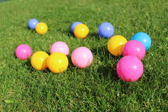 Colourful Balls. Colourful plastic balls on grass stock photography