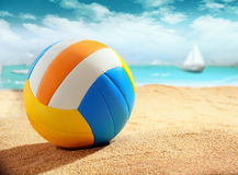 Colourful beach ball on the sand Stock Photography