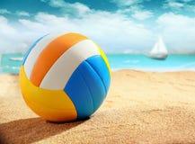 Colourful beach ball on the sand stock photography