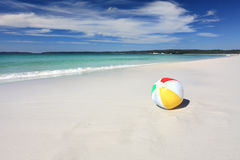 Colourful beach ball on the seashore by the ocean Royalty Free Stock Photography