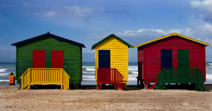 Colourful beach cabins. With solitary figure Royalty Free Stock Photos