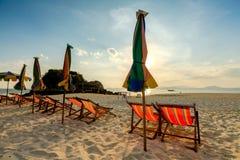 Colourful beach chairs on the white sand beach. Beach chairs on the white sand beach stock images