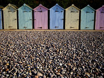 Colourful beach huts. Row of pastel colored beach huts at the shore Royalty Free Stock Images