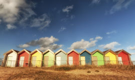 Colourful beach huts. With a soft filter glow Royalty Free Stock Image
