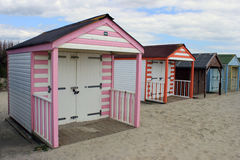 Colourful beach huts on beach Royalty Free Stock Image