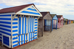Colourful beach huts on beach Royalty Free Stock Photography