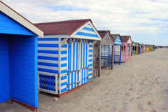 Colourful beach huts on beach landscape Stock Image