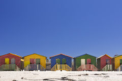 Colourful beach huts on the beach in Muizenberg, South Africa. Old colourful beach huts on the beach in Muizenberg, South Africa on a sunny day Royalty Free Stock Photos
