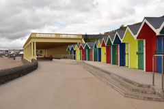 Colourful beach huts. Beach huts brighten up a dull day royalty free stock photo
