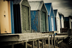 Colourful beach huts with dramatic sky Stock Photography