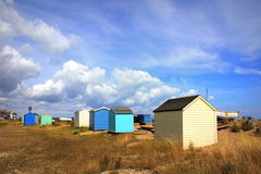 Colourful beach huts Littlestone Kent UK. Colourful beach huts at Littlestone Kent United Kingdom.A beach hut is a small, usually wooden and often brightly Royalty Free Stock Photos