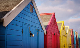 Row of multi coloured beach huts. Stock Images