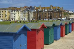 Colourful beach huts in South coast of UK. Beach huts in St Leonard's  -south of UK Stock Photos