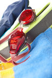 Colourful beach towel and swimming goggles Stock Image