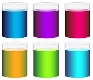 Colourful beakers Royalty Free Stock Photos