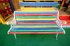 Colourful bench. Multi-coloured bench made from different painted wooden boards royalty free stock photo