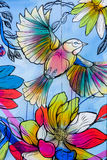 Colourful bird and flower grafitti Stock Photo