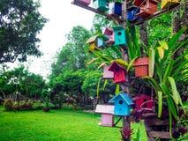 Colourful bird house in a Garden. Colourful bird house in a Garden royalty free stock photos
