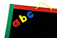 Colourful blackboard. Colourful black board on white.  Concept of fun learning Stock Images