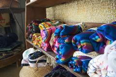 Colourful blankets displayed on shelves in a store, close up Stock Images