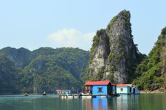 Vietnam - Ha Long Bay - colourful blue wooden houses at floating village of Vung Vieng Stock Photography