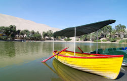 Colourful Boat at an oasis in Peru royalty free stock images
