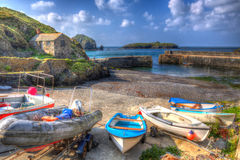Colourful boats in the harbour Mullion Cornwall UK in vivid bright HDR Stock Photo