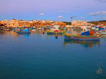Colourful boats in Marsaxlokk harbor. Colourful traditional fishing boats in the harbor of Marsaxlokk in Malta Royalty Free Stock Image