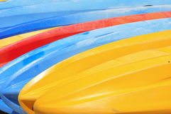 Colourful boats. A rack of colourful boats at a local surf club Royalty Free Stock Images