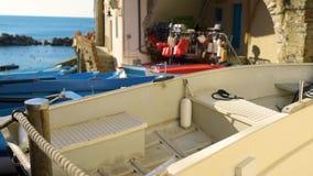 Colourful boats in tiny marina of Riomaggiore, Cinque Terre, Liguria, Italy